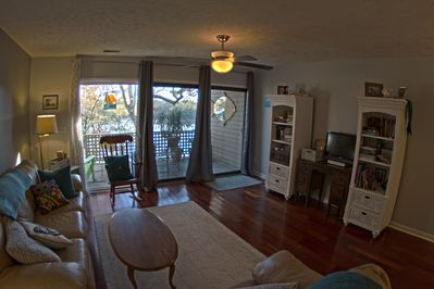 Enjoy a view of the Cape Fear River from the cozy living room.