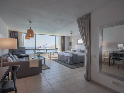 Photo for DIRECTLY ON THE BEACH BY ELEVATOR WITH THE MOST SPECTACULAR VIEWS AND SUNSETS