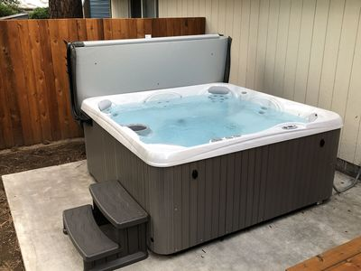 Photo for Riverwoods Relaxation - Fall Discount!! - Private HOT TUB, A/C, Updated, Pine Trees, Close to Town