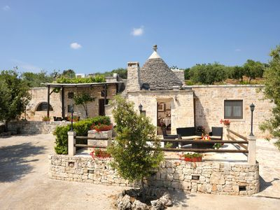 Photo for Spectacular trullo with pool-jacuzzi- sport area