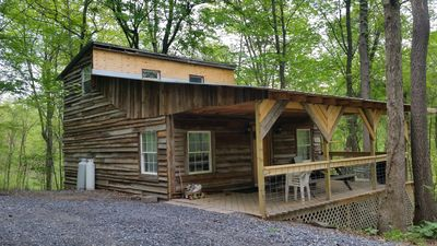 Photo for Comfy cabin in the woods with huge party deck