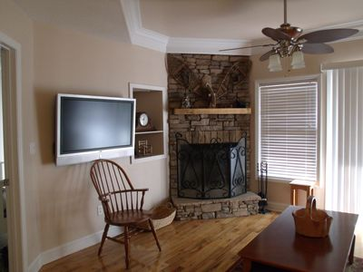 Wood burning fireplace located in downstairs living area.
