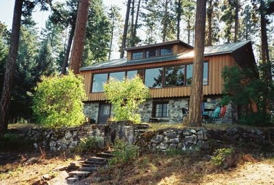 Charming log home offers great views and lake front.
