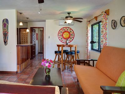 Photo for Ocean view condo, close to town, shared pool, daily housekeeping.