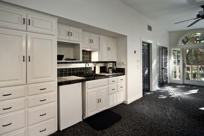 Kitchenette with microwave and under counter refrigerator