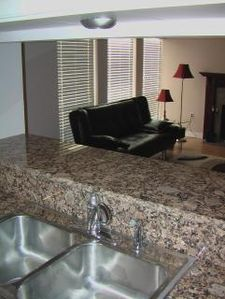 Granite countertops on kitchen that connects to living and dining room areas