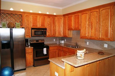 Full size appliance kitchen with granite countertop