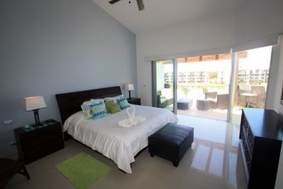 Master bedroom with king bed, TV and ocean view