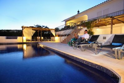 Enjoy a poolside cocktail in the illuminated pool and gardens.