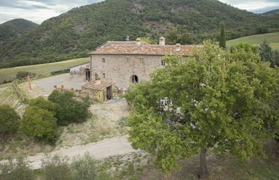 Photo for Stunning private villa with hot tub, private pool, WIFI, A/C, TV, patio, close to San Gimignano