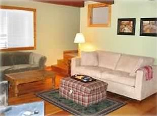 Living room with Sofabed, Wood Stove, TV/ VCR/ DVD/Stereo/Cable and bumper pool