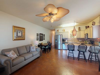 Photo for Dog-friendly condo w/ shared pool, gas grills - close to the beach