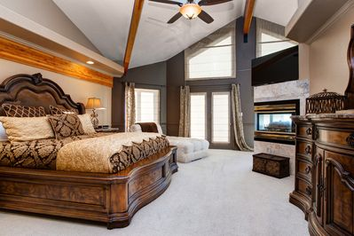 """Master  - The magnificent master bedroom has a king-size bed, chaise lounge, and a 50"""" flat-screen"""