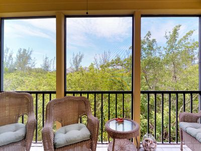 Photo for NEW LISTING! Charming condo w/shared tennis courts & pool - steps to the beach