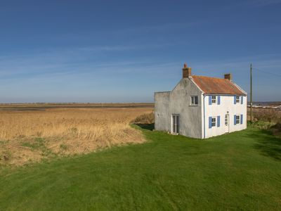 Photo for This delightful four-bedroom house is located on the marsh at Brancaster Staithe