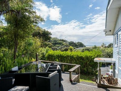 Photo for Blue Views - Cute, sunny, pet friendly (small dogs) kiwi bach in handy location for surf and sand