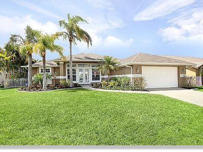Photo for Villa 'Timeless Spell' on the canal with pool and boat dock in Cape Coral. Florida