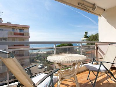 Photo for Cozy studio with sea view, large terrace, parking and bike rental + cabrio