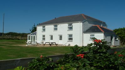 Photo for Large garden, walking distance of beach, sleeps 6/9, en-suite, very peaceful