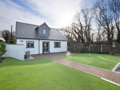 Photo for This contemporary cottage with a private hot tub and log burner offers a spacious, welcoming retreat