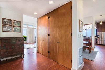 Two floor-to-ceiling brown closets