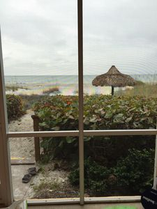 Photo for Directly on the sand of private beach on Longboat key, closest to the ocean.