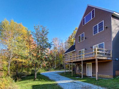 Photo for Secluded, rustic home w/ private hot tub & huge deck - 5 miles to Okemo