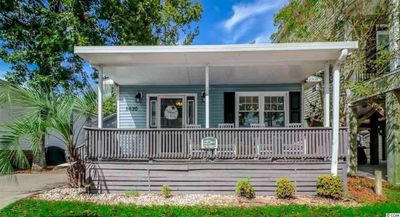 Photo for RENOVATED BEACH COTTAGE WITH WI-FI AND GOLF CART INCLUDED