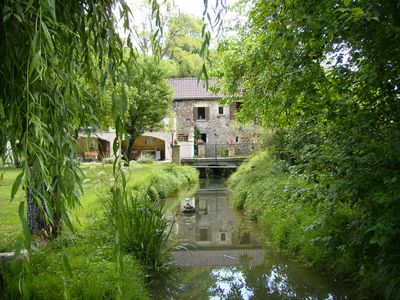 Photo for Watermill with pool on the edge of a lively village in the heart of the Dordogne