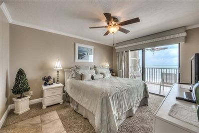 Master Bedroom w lanai access - enjoy the sound of the surf as you drift off.