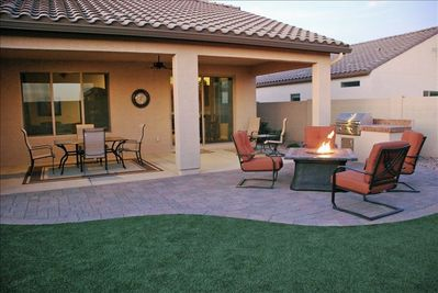 Private back yard with gas BBQ, and sitting area with gas fired patio table