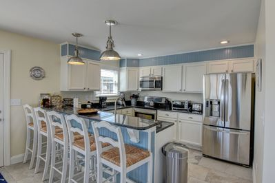 All the bells and whistles in the modern granite counter top kitchen