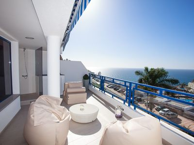 Photo for Modern designer apartment with large terrace and view of the sea!