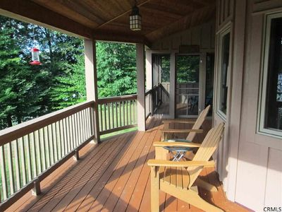 Wrap around porch with screened sitting area