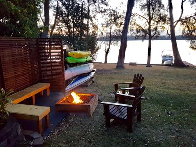 Relaxing Fire Pit along with Canoes and Kayaks for guest use.