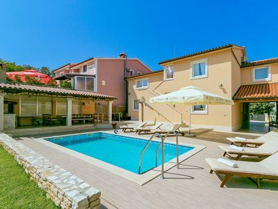 Photo for This 7-bedroom villa for up to 16 guests is located in Porec and has a private swimming pool, air-co