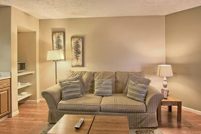 Living room - This cozy living room is perfect to relax in seated in a nice sized recliner or the love seat.