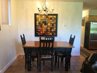 dining table with placemats and napkins in the drawer