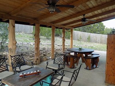 Front porch with sitting area and dining area