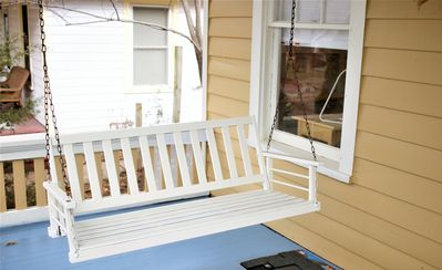 A porch swing for enjoying the quiet tree-lined street in historic OWL.