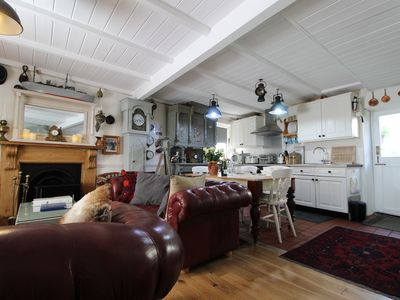 Photo for Grade II listed vintage cottage located right on the Harbour Front