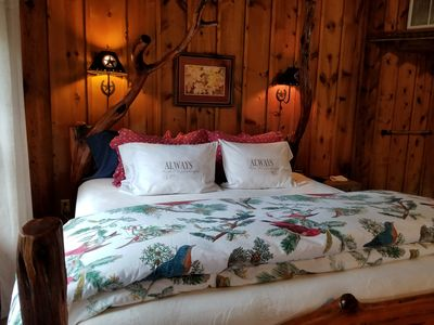 Luxury linens adorn the custom cedar & cypress bed made from reclaimed wood.