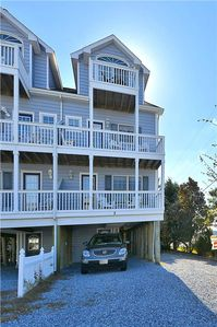 Photo for FREE DAILY ACTIVITIES!  Beautiful 4 bedroom, 3.5 bath multi-level vacation townhouse is just steps from the private beach and offers glorious sunsets over the bay!