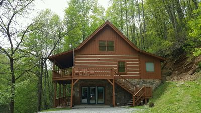 Photo for Secluded Log Cabin has Wifi, hot tub, pool access, and much more!