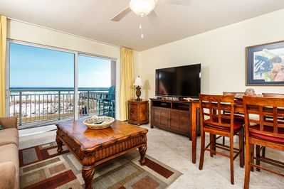 Beautiful views - Beautiful furniture is found throughout this elegant beach condo. The view from your living room is wonderful, you can also see the pool just outside your private balcony.