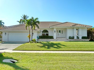 Photo for Charming waterfront home w/ heated pool just a short from the beach