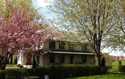 Photo for Gorgeous Historical home * POOL opens in May * Large screened porch * Private.