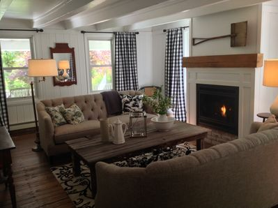 The living room features a coffee table crafted from a beautiful barn door.