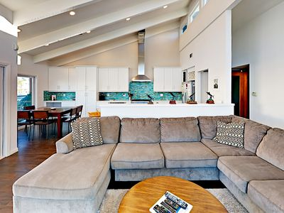 Living Room - The recently remodeled home features vaulted ceilings and an oversized sectional sofa in the living room.
