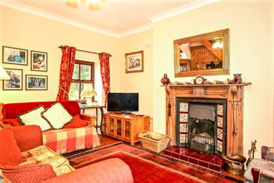 Sitting Room with open Fire (plus Central heating via  radiators to all rooms)